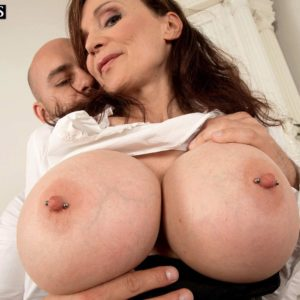 Brunette cougar Michaela O'Brilliant having huge breasts revealed before delivering BLOW JOB