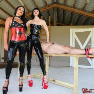 Brunette Dominas Jean Bardot and Michelle Lacy dominate stud on confine bondage table