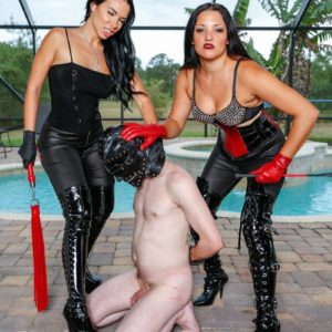Brunette Domineering type Kylie Rogue and mistress abuse hooded subby husband beside pool