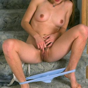 Brunette first-timer baring furry armpits and fur covered cootchie while disrobing