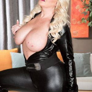 Chunky sandy-haired model Holly Knob letting immense all-natural funbags loose from leather garb