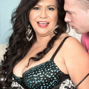 Dark haired MILF over 50 Victoria Versaci uncovering monster-sized butt while being stripped