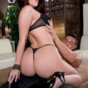 Dark haired MILF Ryan Smiles demonstrating big ass in g-string panties and high-heeled shoes