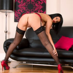 Elder brown-haired model exposing perfect melons in seductive black nylons and high heels