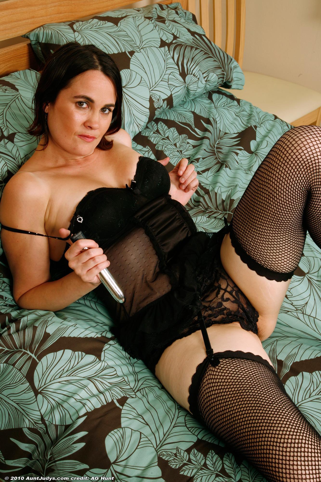 elderly brunette doll in black pantyhose ramming sex toy into