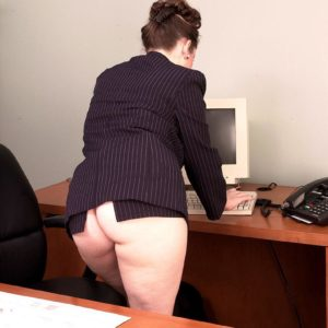 Euro MILF X-rated star Desirae showcasing immense upskirt butt in work place attired stilettos