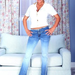 Fair-haired MILF adult flick star Autumn Jade loosing monster-sized titties while doffing denim jeans