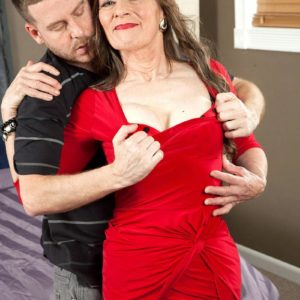 Hosiery and high heel outfitted grandma Mona readying for sex with junior stud