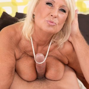 Huge-boobed light-haired grandma in stockings and lingerie delivering hefty sausage tit job and blowjobs