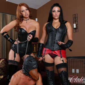 Leather garbed Dommes Michelle & Lacy manhandling hooded masculine submissive in lengthy boots