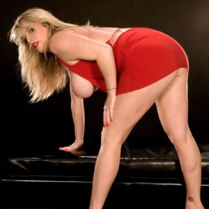 Long-legged blond babe Maggie Lime extracting large all natural funbags from sundress