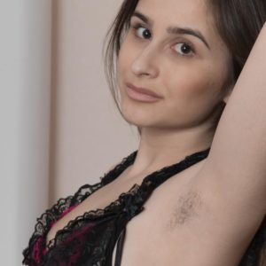 Long-limbed Euro amateur Penelope Fiore displaying unshaven underarms and spread snatch