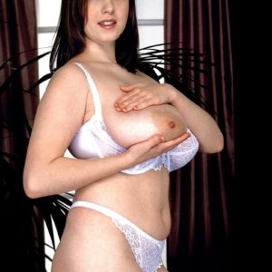 MILF X-rated star Nicole Peters freeing enormous boobs from white brassiere in lace panties