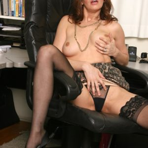 Mischievous senior chief gal undressing down to hosiery and heels in her work environment