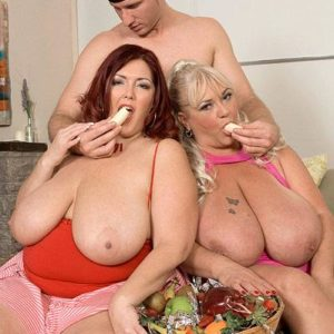 Obese damsels Shugar and Peaches LaRue providing lengthy dick blow job while munching food