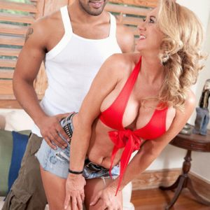 Old light-haired lady Cali Houston loosing large melons while seducing younger man
