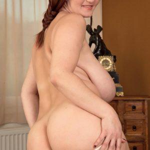 Plump babe Vanessa Y. showing off large tush before unsheathing large boobs