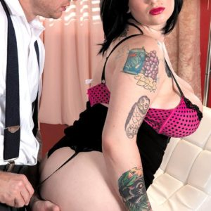 Plumper black-haired babe Scarlet LaVey vaunting tattoos in lingerie and pantyhose