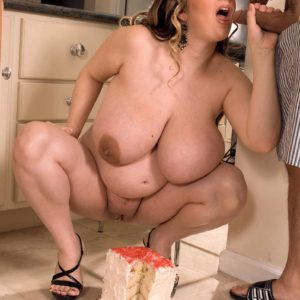 Plus-sized girl April McKenzie flashing gigantic fun bags while sucking cock and sucking food
