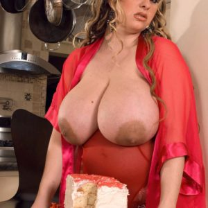 Plus-sized girl April McKenzie flashing gigantic fun bags while sucking cock and sucking food