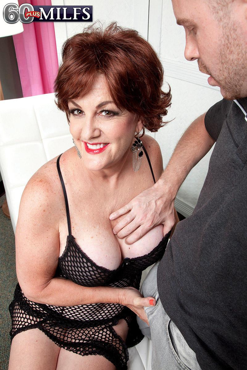 Red-haired granny Gabriella LaMay releasing enormous hooters and hard nipples from bodystocking