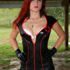 Redheaded bossy type Amadahy strutting outdoors in spandex clothing, boots and gloves