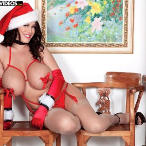 Stellar black-haired MILF porno star Leanne Crow showing off giant fun bags at Christmas