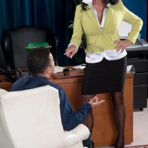 Stocking and mini-skirt adorned grandma Rita Daniels undressing down to lingerie in work place