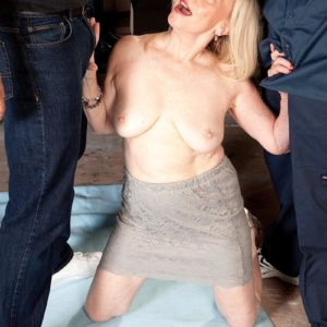 60 plus blond grandmother Miranda Torri revealing enormous experienced tits before MMF Three-way