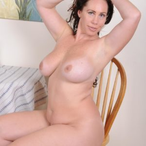 Accomplished dark-haired broad unleashing big all natural titties and enormous ass