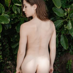 Amateur solo female Kasey Warner gliding shorts and undies over fur covered vagina outdoors