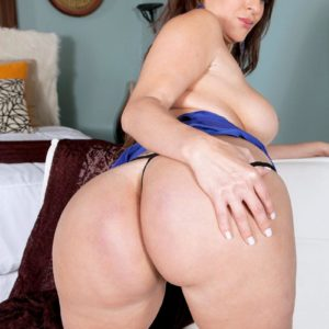 Black-haired MILF Vanessa Luna flashing monster-sized butt and tats before exposing humungous boobs