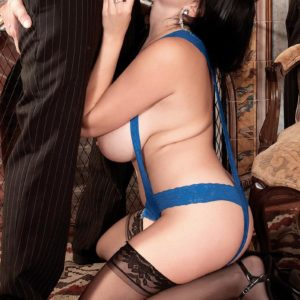 Black-haired stunner Shione Cooper eating wood while demonstrating super-cute hooters in hosiery
