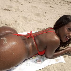 Black solo female Sapphira vaunting giant butt on beach clad crimson swimsuit