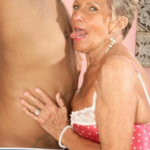 Bosomy stocking and lingerie outfitted Seventy plus grandmother Sandra Ann delivering giant black penis a fellatio