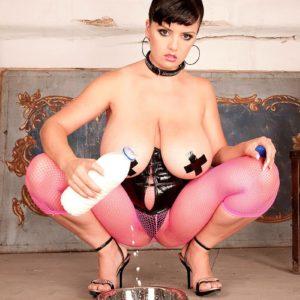 Brunette MILF Arianna Sinn pulling down pink pantyhose during fetish shoot