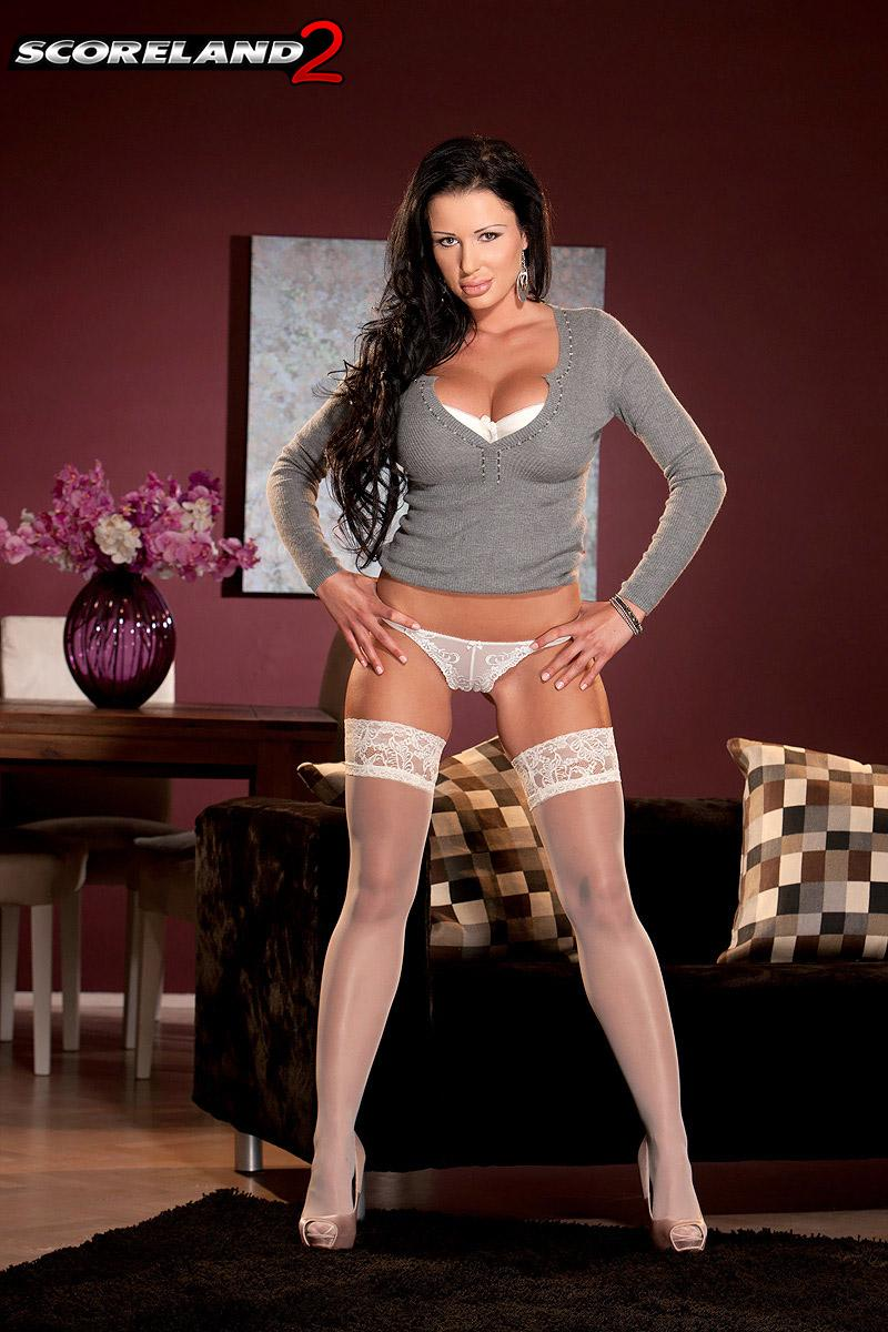Busty European babe Patty Michova modeling in stockings and g-string panties