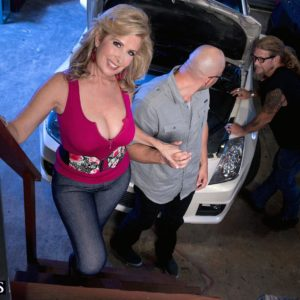 Busty fair-haired cougar Laura Layne seducing mechanics for MMF 3some in garage