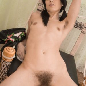 Dark haired European girl Gerda May baring furry cunny and lil' juggs in pigtails