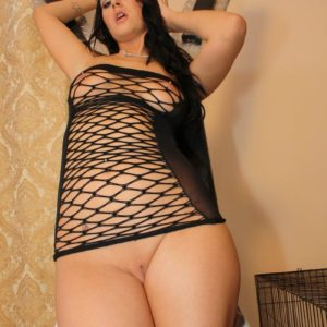 Dark haired Girlfriend Ashley modelling about basement partly naked in fetish outfit