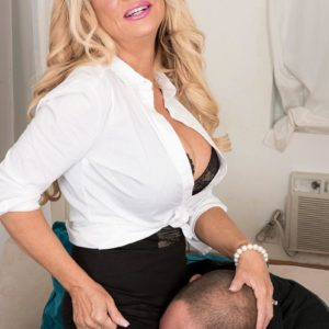 Elder golden-haired chief dame Bella Dea uncovering enormous titties before giving ORAL JOBS in work place