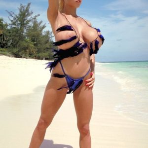 Famous golden-haired XXX actress Tiffany Towers displaying boobies outdoors on beach