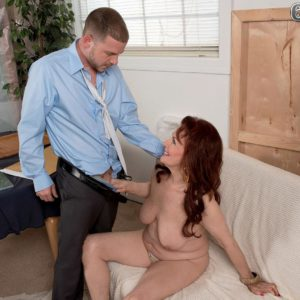 Ginger-haired granny Katherine Merlot baring large flappy mature melons before oral pleasure