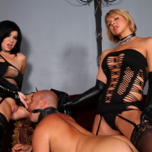 Hot Dommes Belle Noir and Brianna abuse collared male sub in fetish attire