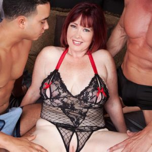 Huge-boobed ginger-haired MILF Heather Barron fucking two enormous peckers during MMF 3 way