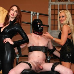 Latex garmented Dommes Zoey and Kendra tugging off held and hooded male sub