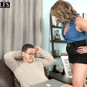 MILF over 50 Catrina Costa seducing boy in glasses wearing short microskirt and high-heels