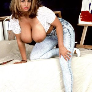 Notorious MILF porno starlet Tawny Peaks letting out monster tits wearing faded denim jeans
