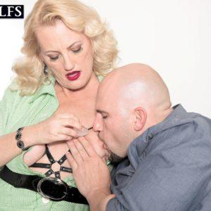 Over Fifty ash-blonde lady Lady Dulbin seducing junior boy in nippleless brassiere