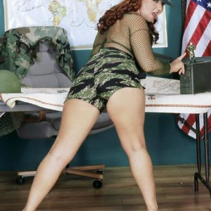 Plump ginger-haired MILF Virgin Brady unsheathing big hooters in military fatigues
